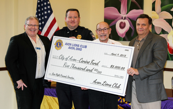 (from L-R) Lion's Club President Ian Murray, AVon Police Chief Richard A. Bosley, Doug Wetzig and Mayor Bryan Jensen.  Photo by David Mooibroek